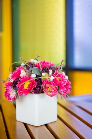 a photo of decorate flower on wooden table photo