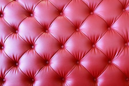 a photo of close up leather upholstery sofa,classic retro photo