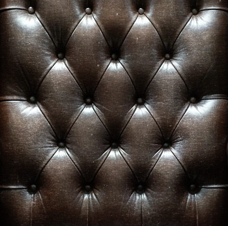 a photo of close up leather upholstery sofa,classic retro photo