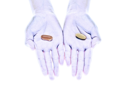 a photo of hands with medicine and supplement isolated
