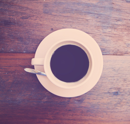 a photo of close up coffee in white cup,top view Stock Photo