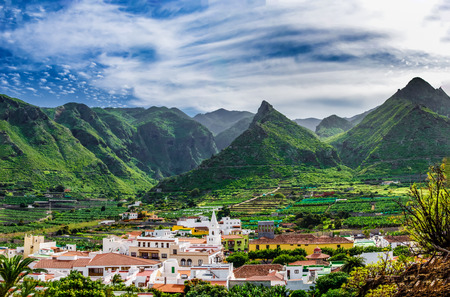 The small town of Los Silos is situated on the edge of the Teno Mountains in the Northwest of Tenerife. In the background is the vulka This view shows the center of the small town of Los Silos from the hill Aregume. In the background the volcanic Teno mou