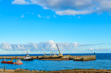 work boat: The Port of Santa Cruz de Tenerife situated on the coast of the Icelands capital and very close to the Town Center. Stock Photo
