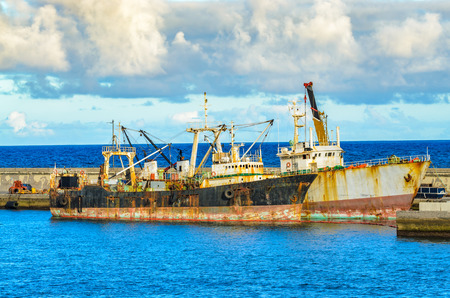 work boat: The Port of Santa Cruz de Tenerife situated on the coast of the Icelands capital.