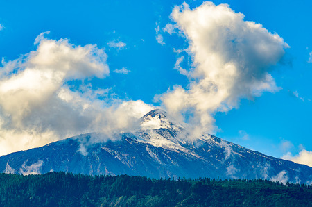 The Teide, a volcano on Tenerife is the highest mountain in Spain. The first snow has fallen overnight. The White Peaks is now rutted and littered with gravel, there are vast forests below.