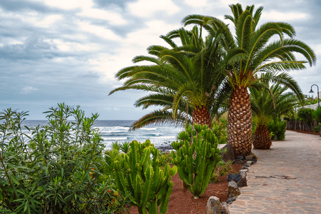 The beach promenade - La Caleta de Interina small town located on the north coast of Tenerife between Los Silos and Garachico. Stock Photo