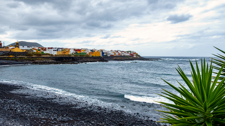 On the beach in stormy weather - La Caleta de Interina small town located on the north coast of Tenerife between Los Silos and Garachico.