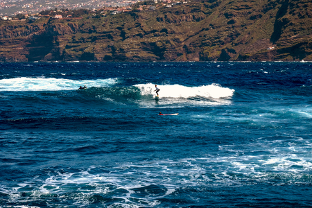 2019-03-21 Puerto de la Cruz, Spain - Surfers use the strong waves in the Bay Martianez.