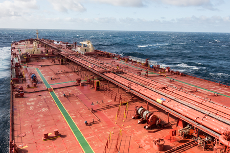 Oil tanker deck in open sea, while stormy weather - stock photo.