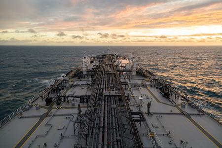 birdeye: Bird-eye perspective of the tanker during sunset in ocean. Stock Photo