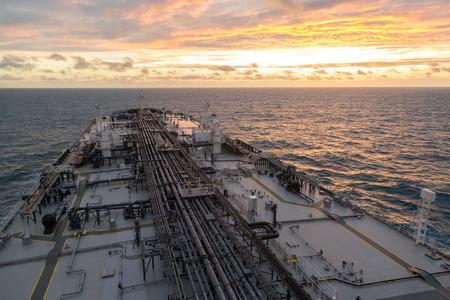 birdeye: Oil tanker deck during sunset - bird-eye view.