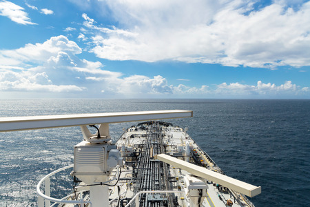 proceeding: Radar aerials of the oil tanker proceeding through the ocean