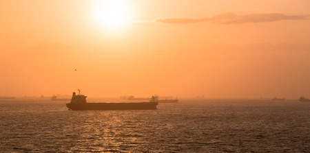 anchorage: Panorama of Fujayrah anchorage with lot of ships while sunset. Stock Photo