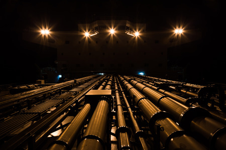 superstructure: Tanker pipeline and superstructure at night - view from fore to aft.
