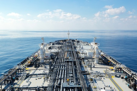 proceeding: Oil tanker proceeding through the calm blue sea
