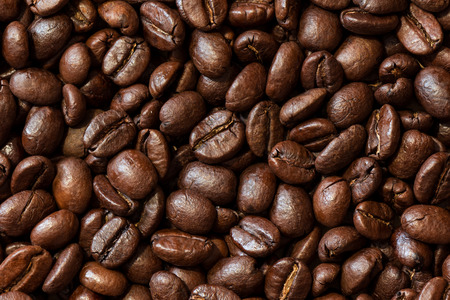 groaning: Background of a roasted coffee beans - stock photo. Stock Photo