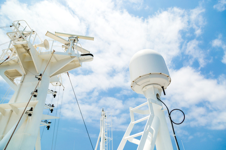 mast: Sattelite communication antenna and radar mast of the cago ship. Stock Photo