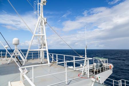 sattelite: Sattelite communication antenna and radar mast of the ship.