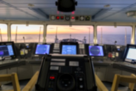 merchant: Blurred navigation bridge of merchant cargo ship. Stock Photo