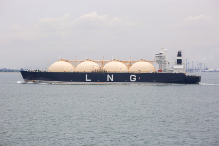 LNG tanker is proceeding through Singapore strait.