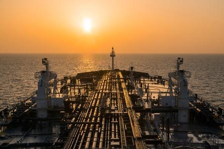 Oil tanker deck during sunrisre.