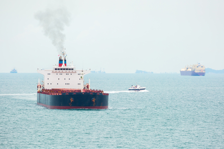 ship bow: Cargo ships is navigating in Singapore strait.