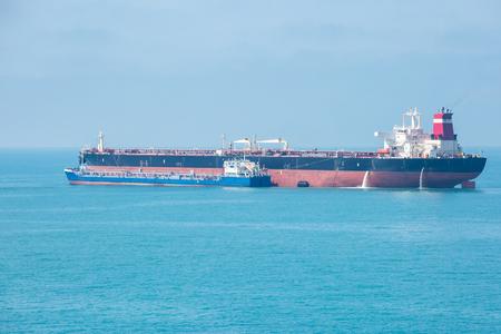 Transfer of oil in the open sea.
