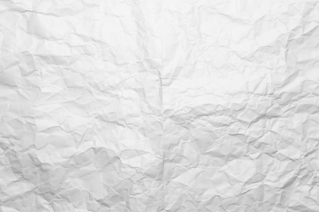 Background of a crumpled white sheet of a paper.