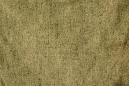The texture of fiber of a sack khaki coloured.