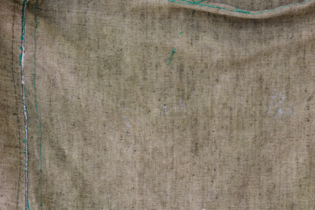 The texture of rumpled fiber of a sack khaki coloured.