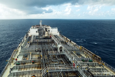 Oil product tanker deck while rainy weather. View from the navigation bridge.