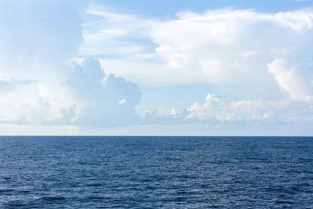 Ocean surface and cloudy sky for natural background.