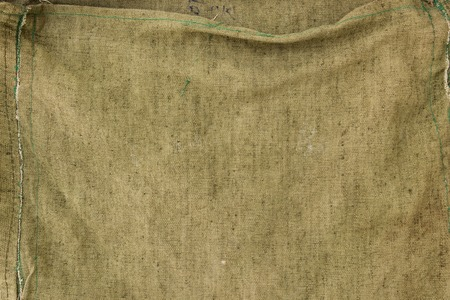Texture of the old burlap with folds khaki colour.
