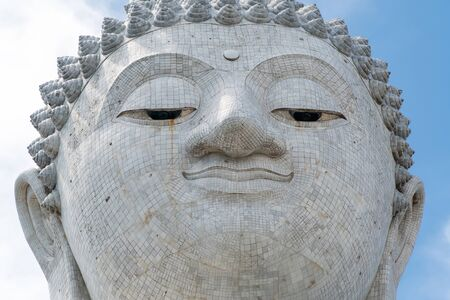 closeup view of big buddha monument face in thailand