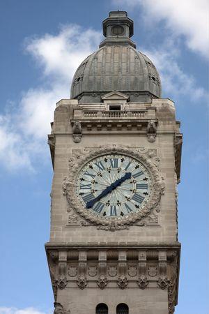 The clock tower of the train station Gare de Lyon in Paris photo