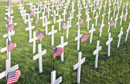 Crosses: Tribute to Fallen Soldiers with American Flags Stock Photo
