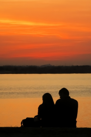 Silhouette of Lovers Against Sunset