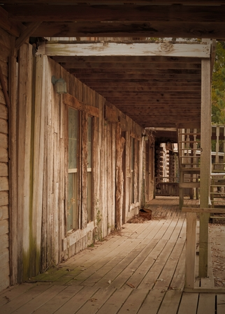 Western Sepia Old Town Sidewalk and Store Front Stock Photo