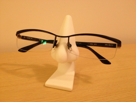 nose: Spectacles on optical holder accessory  Stock Photo