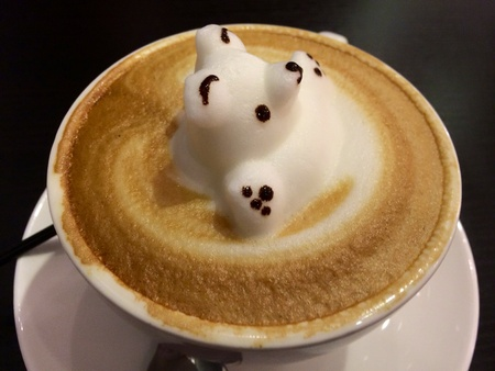 Three dimensional coffee art of white bear