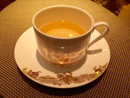 gold: White porcelain tea cup set with gold decorations Stock Photo