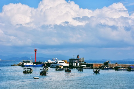 Landscape view of sea with boats and ships Editorial