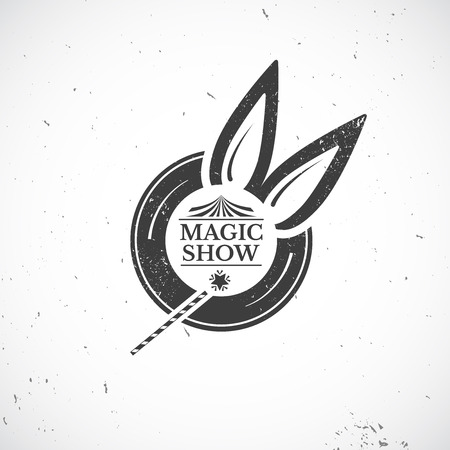 abracadabra: Circus vintage badge, old black hat from which protrude bunny ears with crack and text and magic wand magician isolated on background, magic show illustration