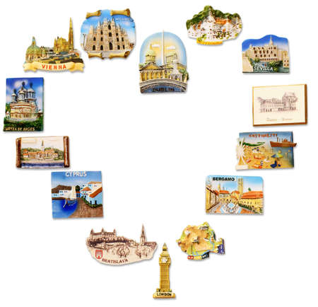 A collection of fridge magnets bought from different visited countries arranged as a heart shape frame Stock Photo - 7904029