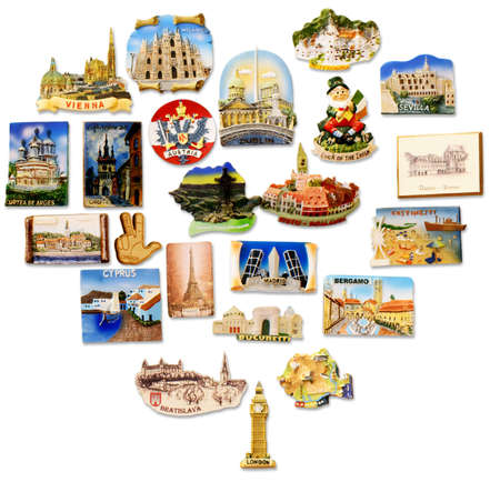 magnets: A collection of fridge magnets bought from different visited countries arranged as a heart
