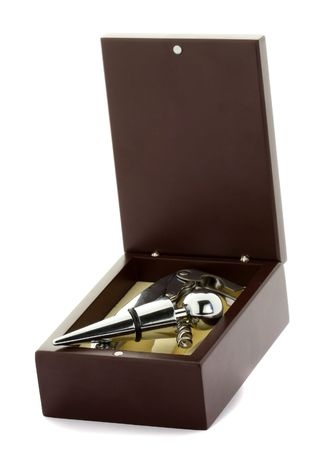 BARWARE: Close up with box with cork and wine opener isolated on white background