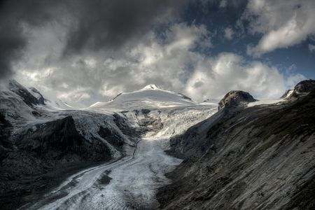 mountain peek: Grossglockner glasier with dramatic clouds