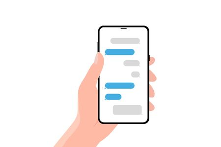 Hand holing smartphone with speech bubble. Using smart phone for text messaging.