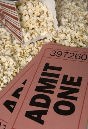 Oversized movie tickets with popcorn to share