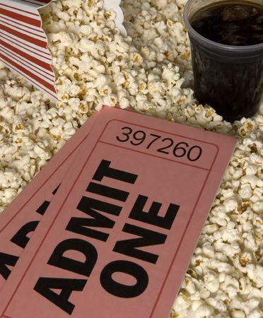 Oversized movie tickets with popcorn and soda
